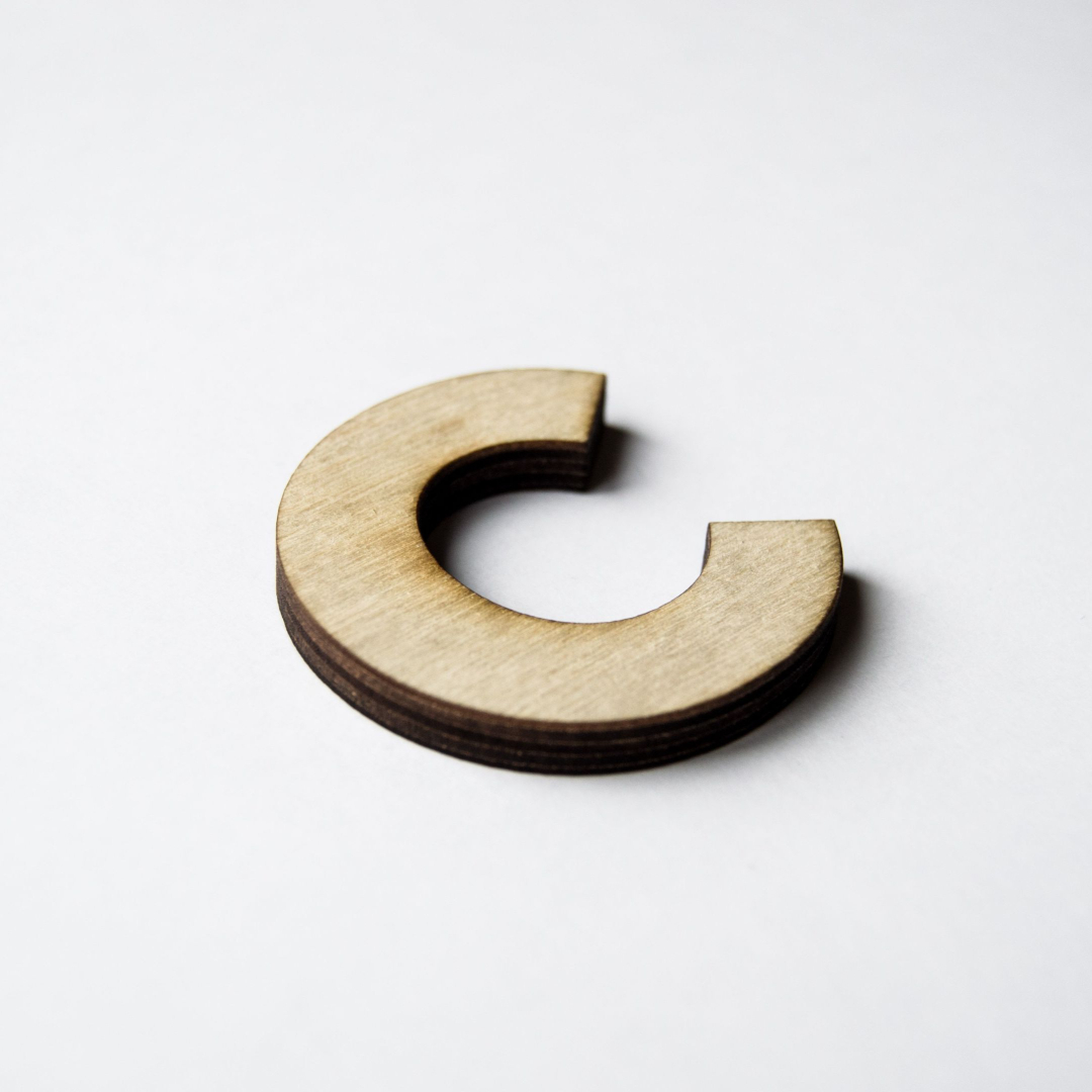 A wooden shaped letter C representing the 10 C's in relationships and sexuality education by Life Connections Ireland