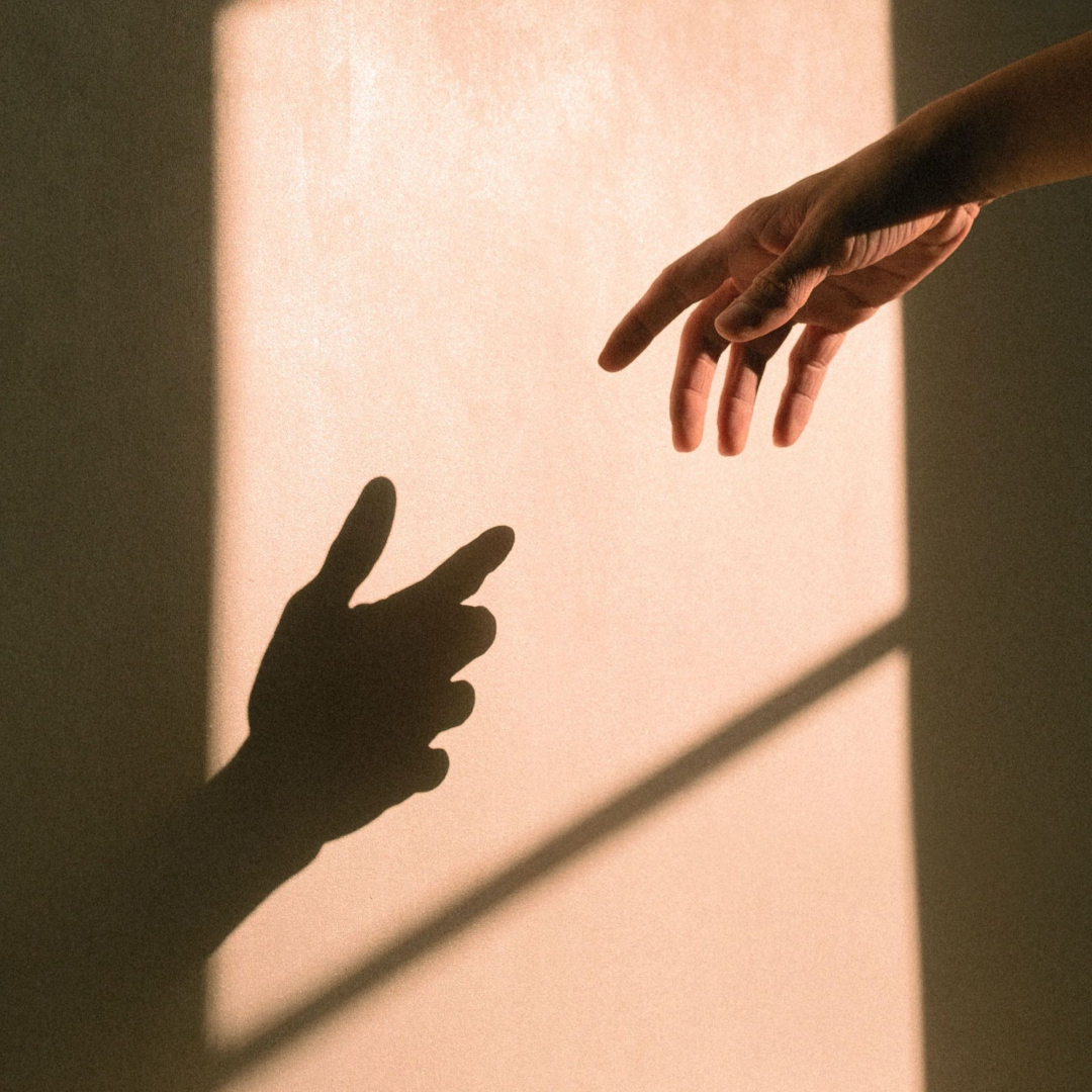 Hand reaching to shadow representing empathy and curiosity by Life Connections Ireland