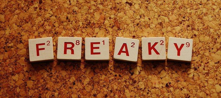 wooden scrabble type letters spelling FREAKY