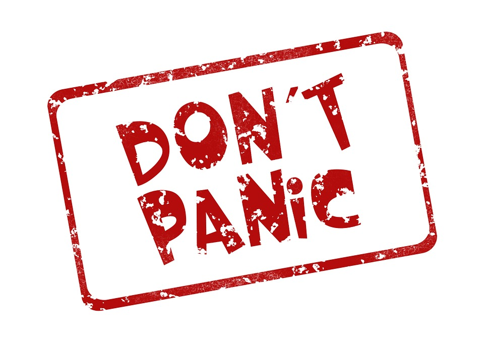 red stamped letters read DON'T PANIC