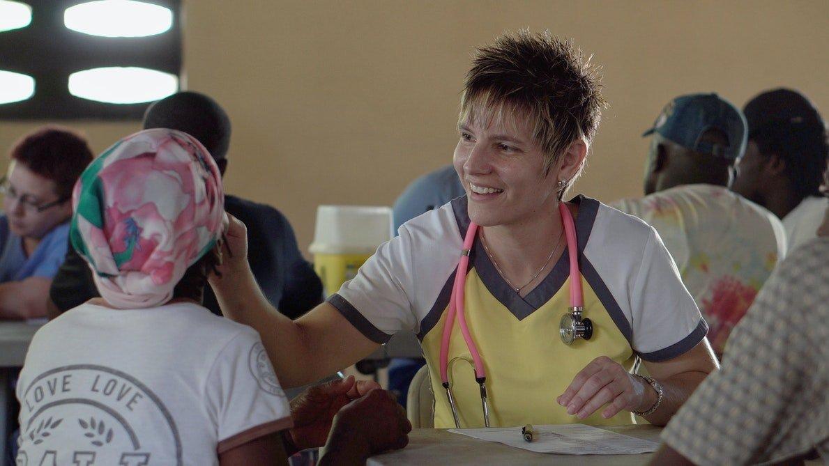 school nurse helping student at table