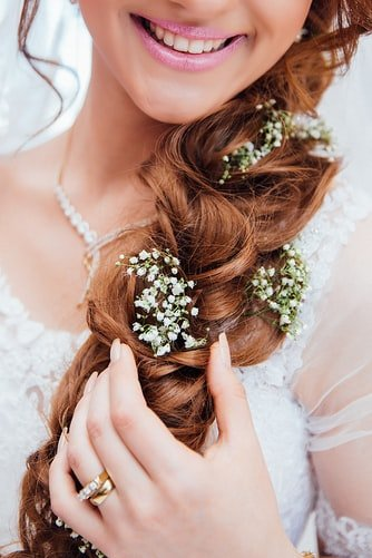 bride with beautiful loopy loose braid.