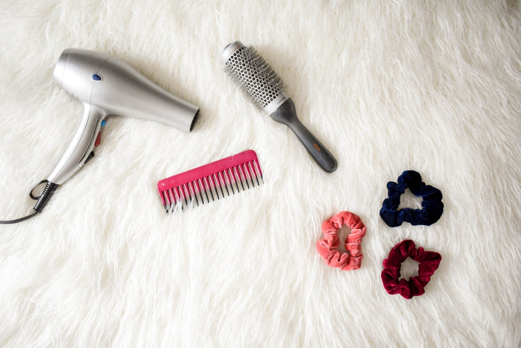 photo of hair dryer comb brush and scrunchy hair bands