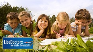 Children studying in the grass - LiceDoctors
