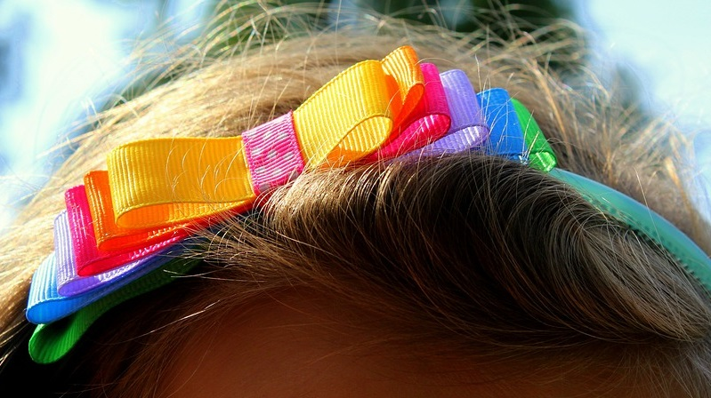 colorful ribbon bow in child's hair