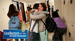 Friends hugging in school hallway