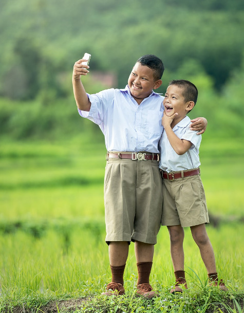 Boys taking selfie picture