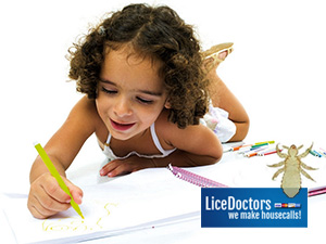 Girl colocing i book - LiceDoctors