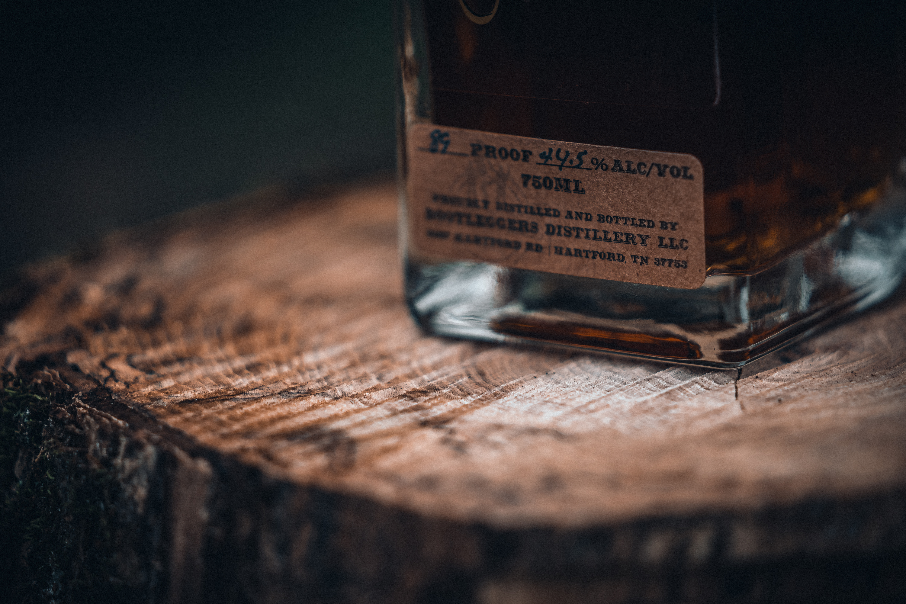 Bootleggers Distillery Whiskey on a log in Hartford Tennessee