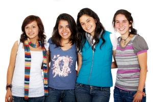 Photo of smiling teenage dental patients