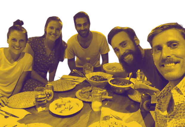 Photo of the Nava team sharing a meal