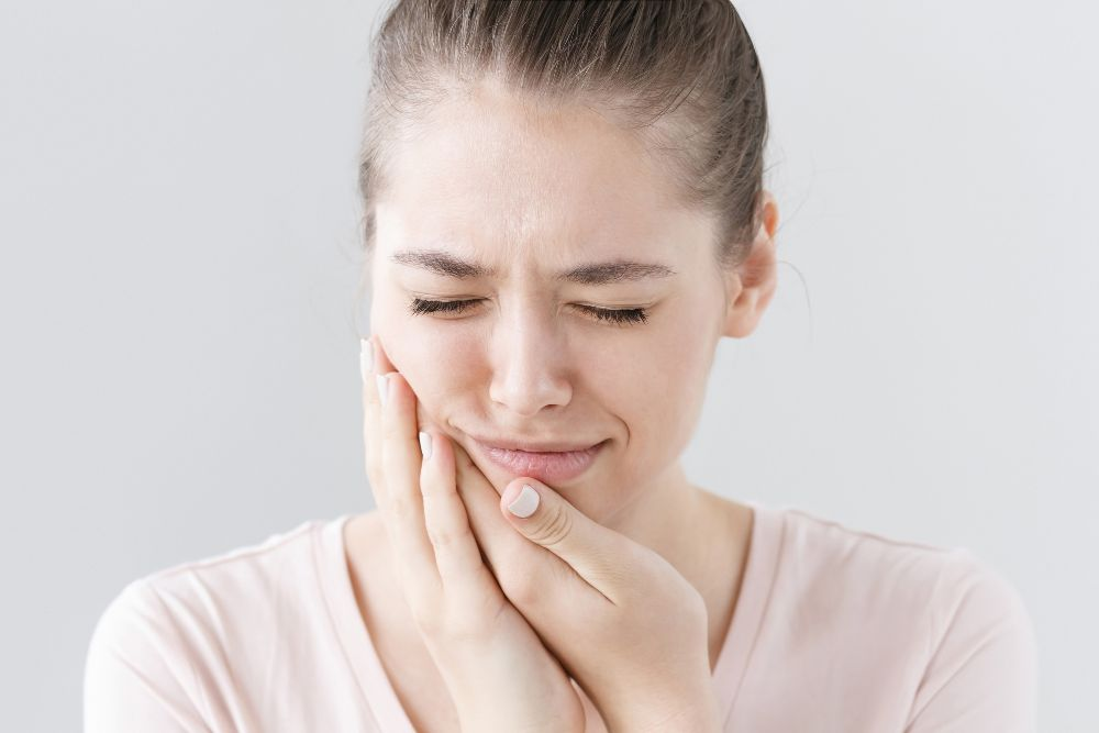 woman in pain from infected tooth