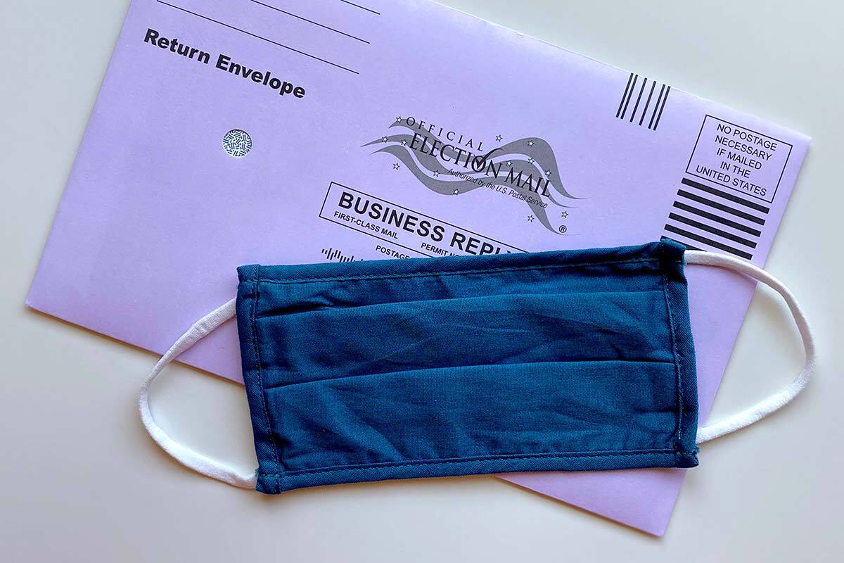 Image of a mask and piece of election mail