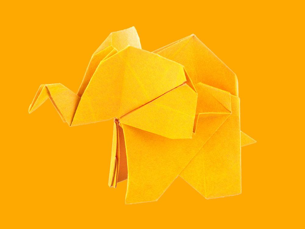 Origamibrettet elefant i gul
