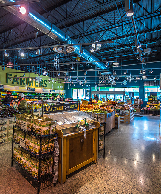 Wide shot of produce section of Whole Foods grocery story