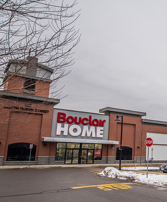 Outside of Bouclair Home store, with a brick exterior and snow on the ground