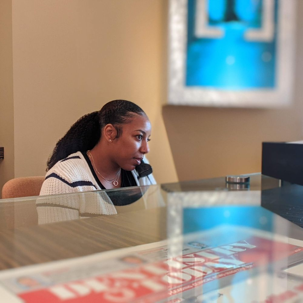 front desk woman worker talking a phone call