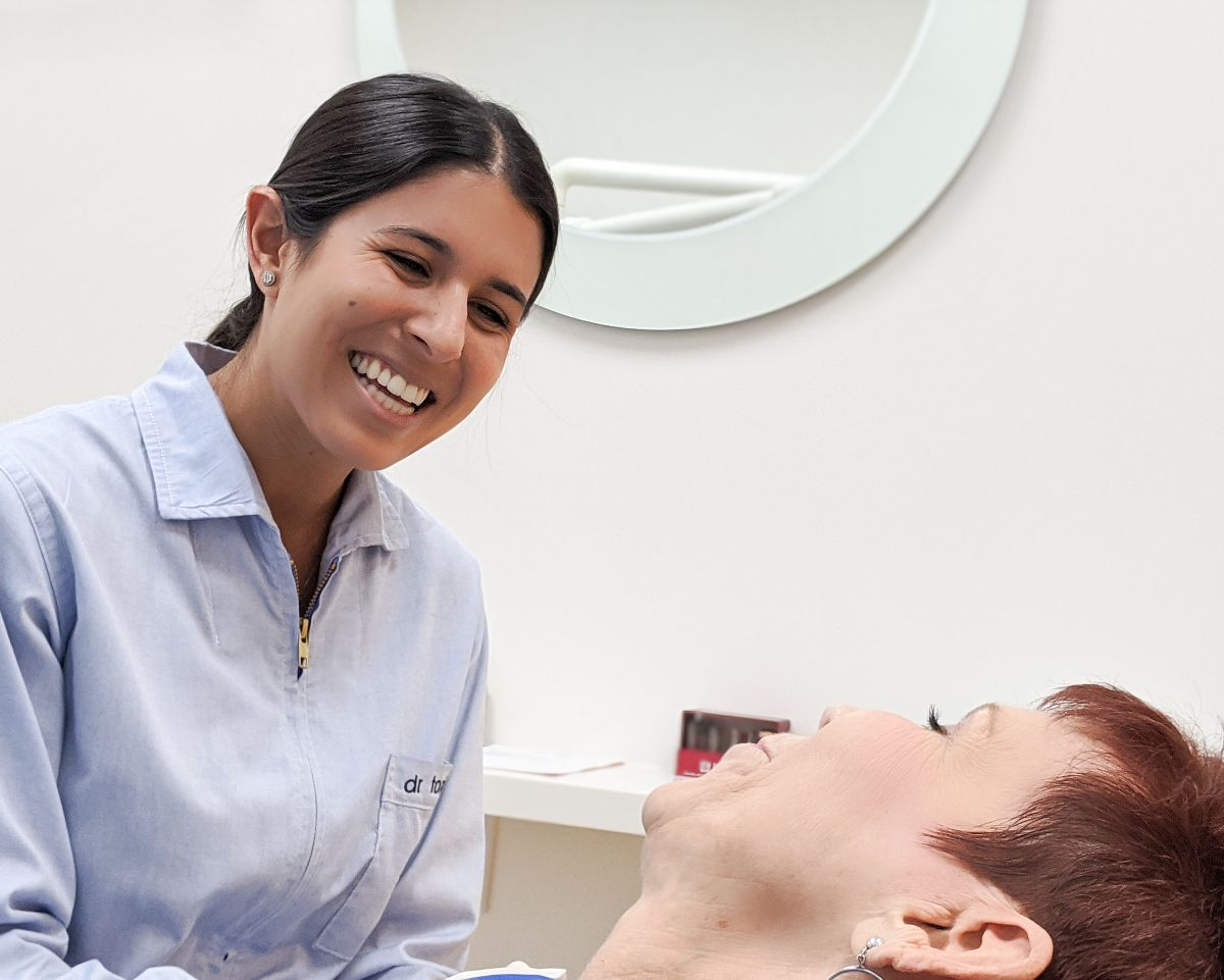 doctor talking to patient and smiling