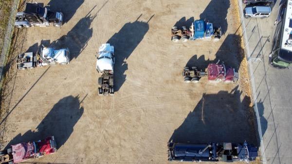 Aerial view of Heavy Duty trucks in the yard at Adrenaline Diesel