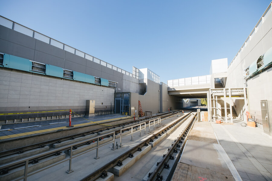 Below street level view of Spring District Station's open-air platforms looking west toward 120th Avenue Northeast.