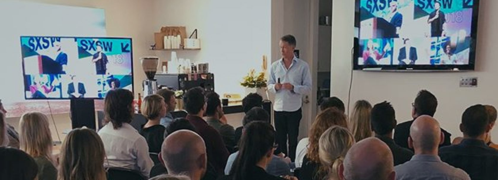 Creative Partner Douglas Nicol presenting to a group of people
