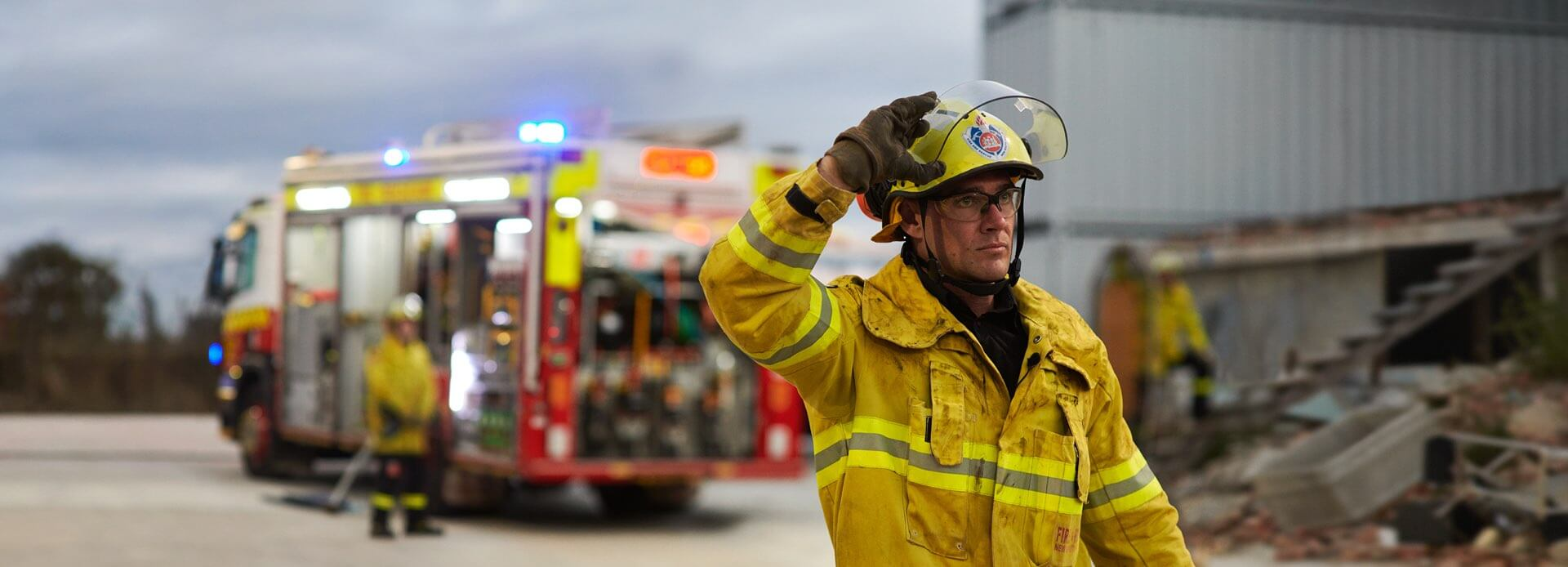 A Firefighter adjusting his helmet. Taken from the Aware Super campaign by The Works.