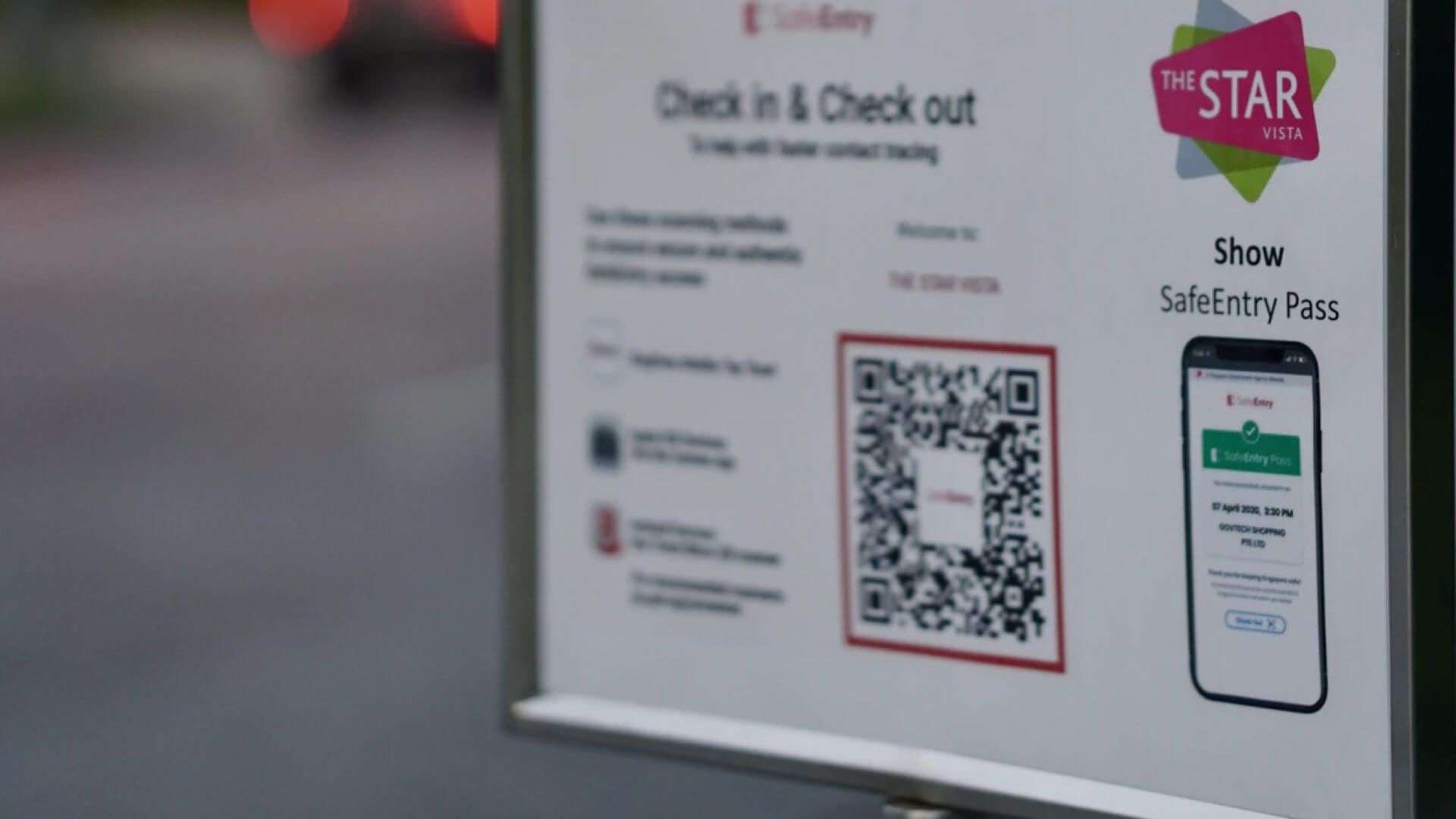 A venue Check-In sign with QR Code.