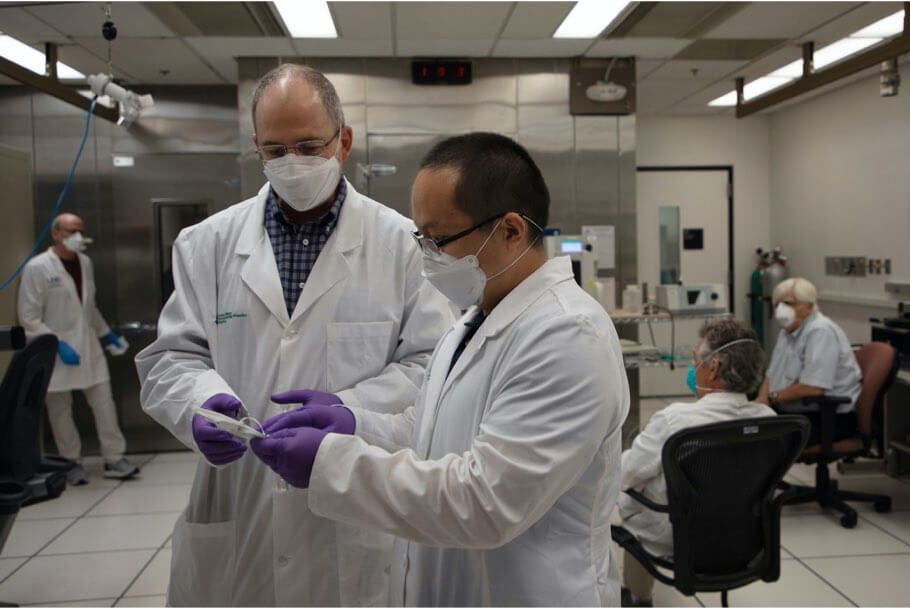 Scientists talking to each other wearing masks