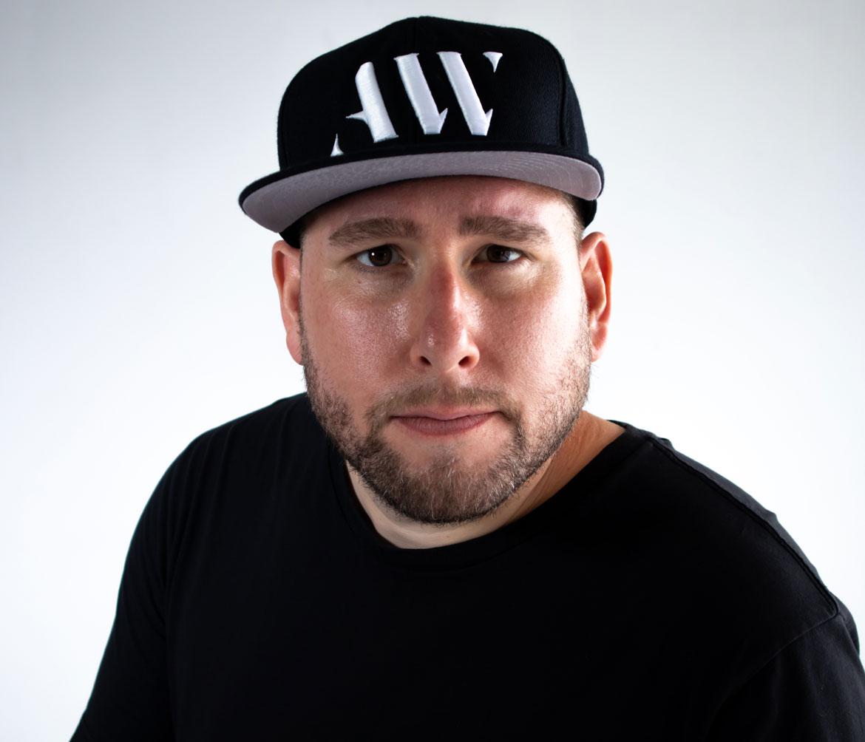 Adam Weitz with Logo Hat