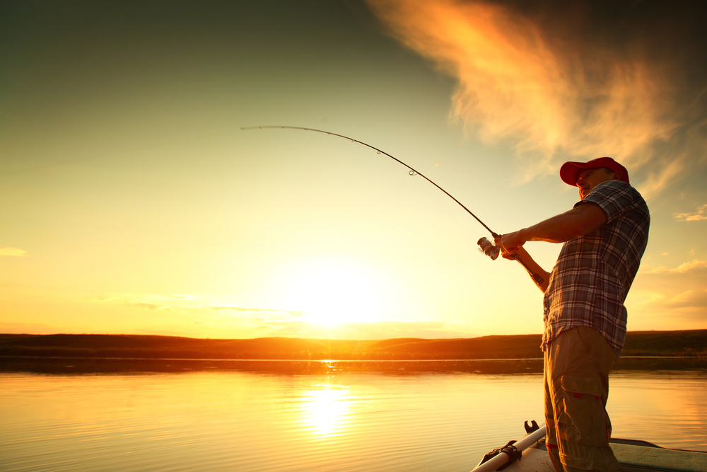 Man Fishing from side of boat