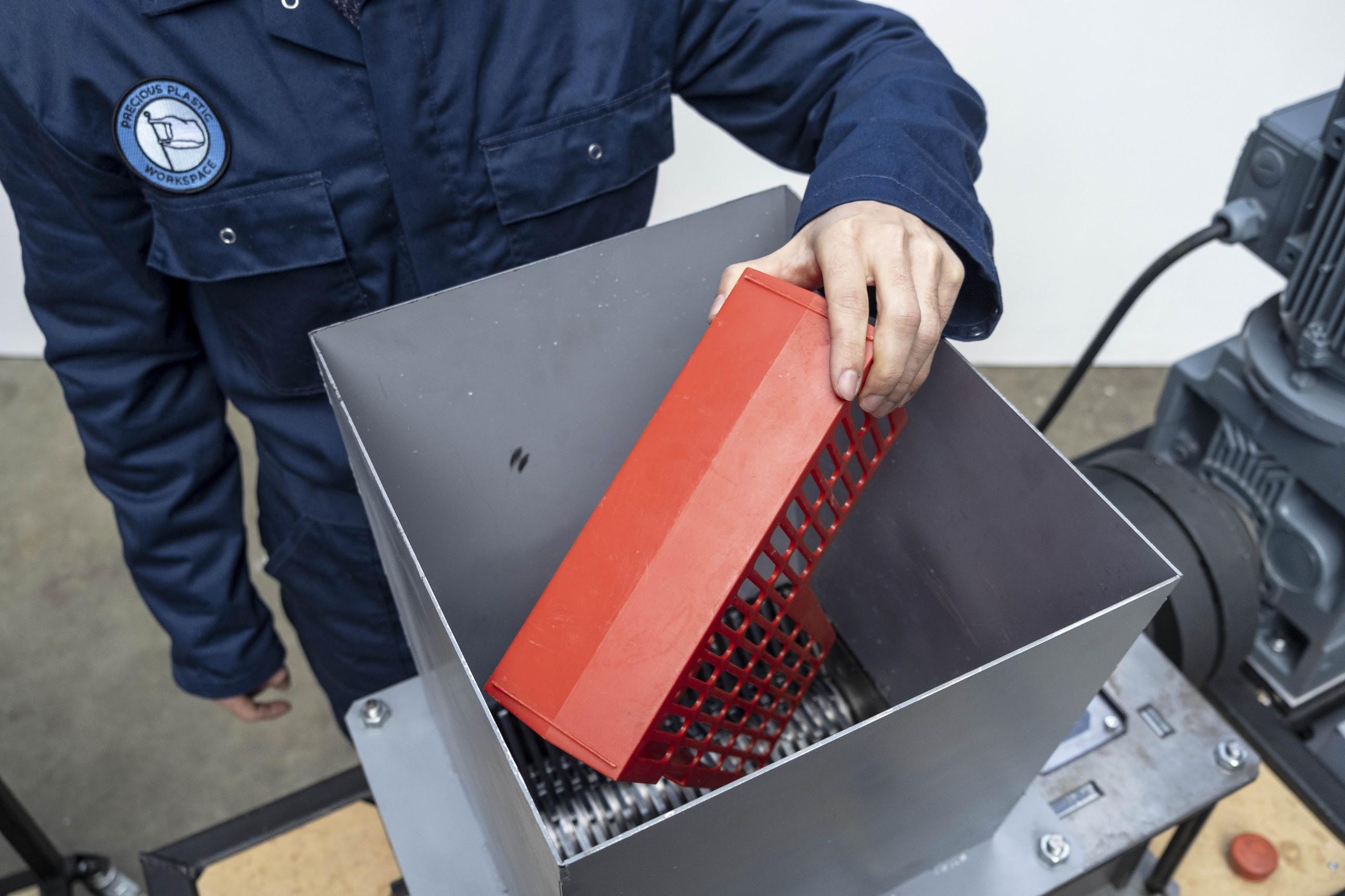 A person shredding plastic