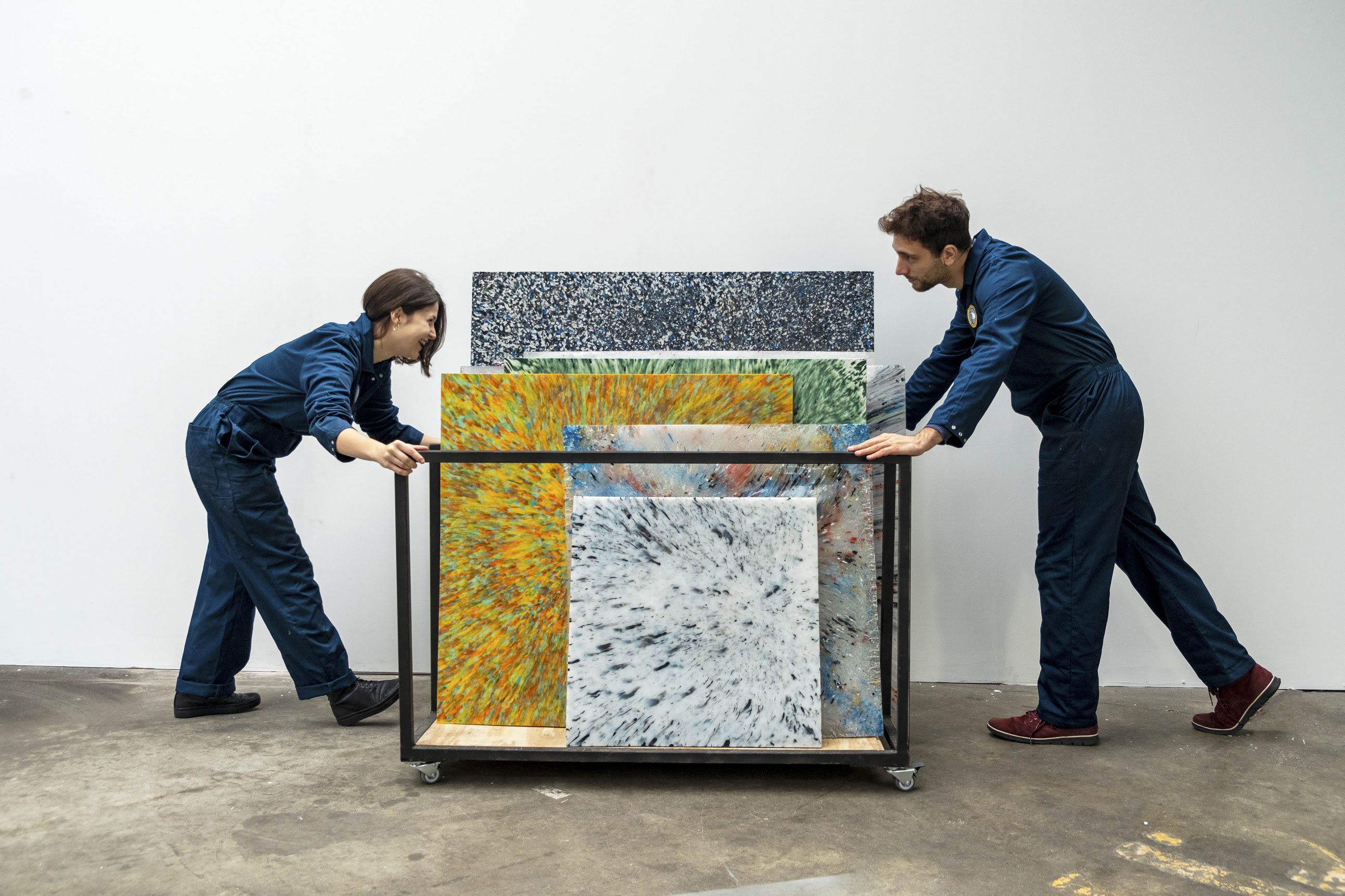 two people working with recycled sheets