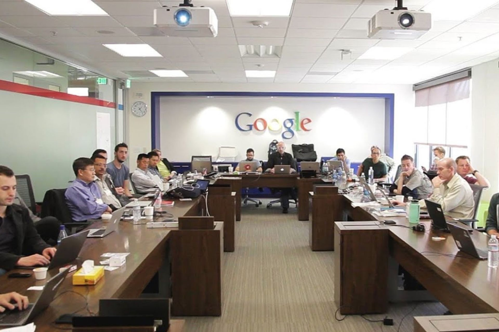A meeting room full of people at google