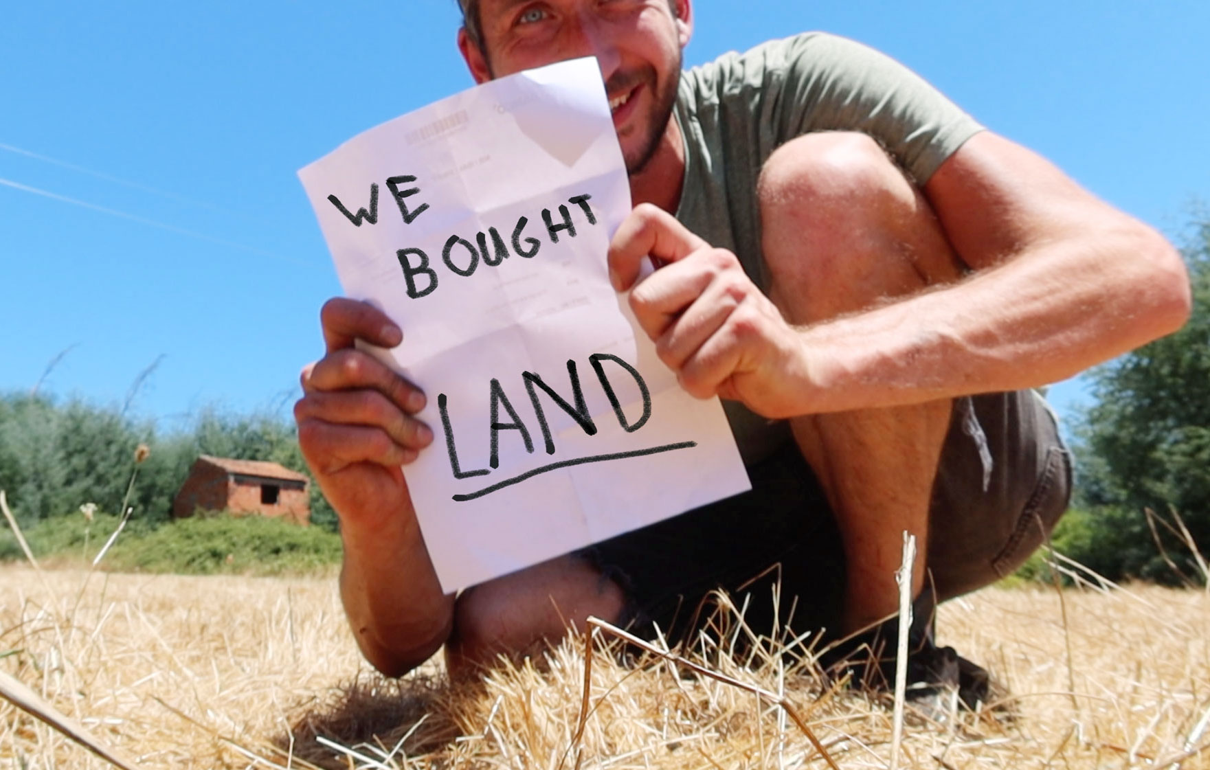 "Man with a sign saying ""we bought land"""