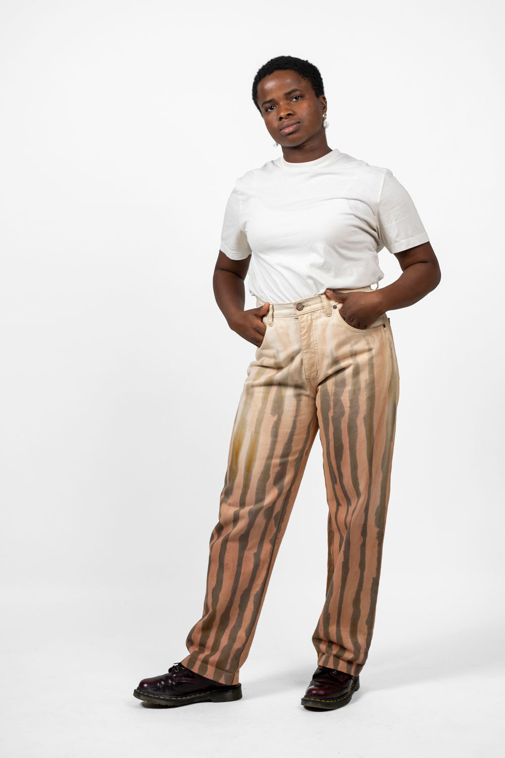 woman proudly wearing repainted trousers