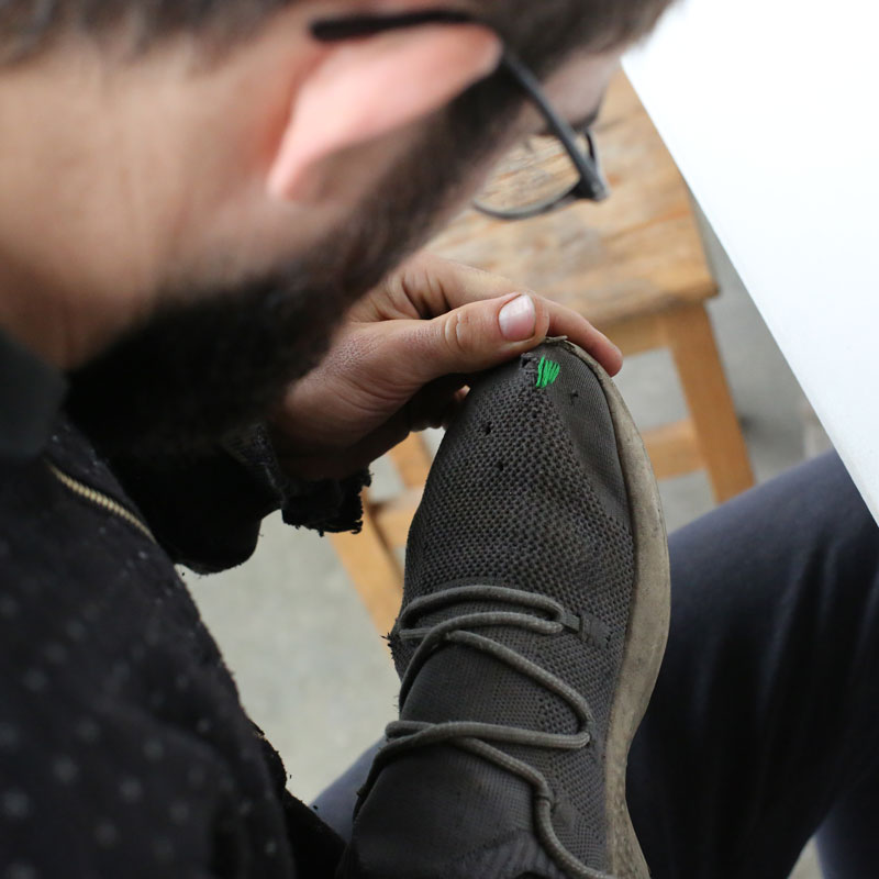 Man fixing his shoes