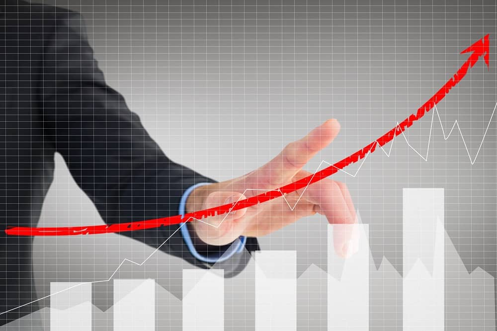Hand of a men in a suit pointing to a chart of increased revenue when promoting 3Dsellers Selling Manager
