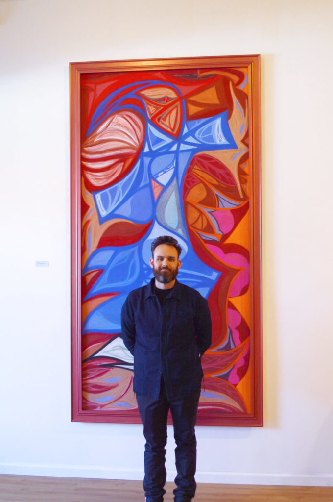 Ian with painting at gallery