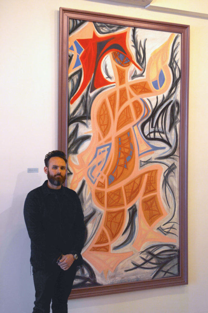 Ian with Painting in Gallery