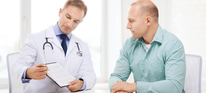 Patient discusses treatment with urology doctor