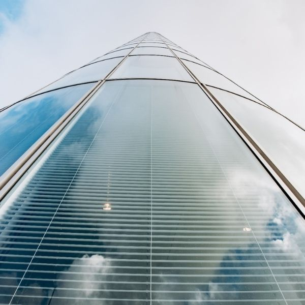 A wide angle shot of a skyscraper from the ground up.