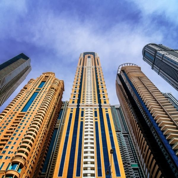 A shot from the ground looking up at a set of high-rise buildings.