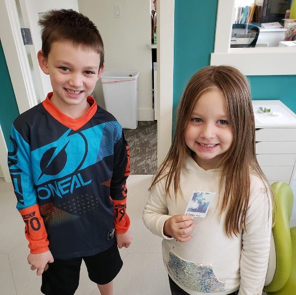 a boy and girl standing and smiling