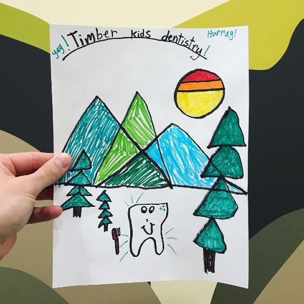 drawing of a timber kids logo by a patient