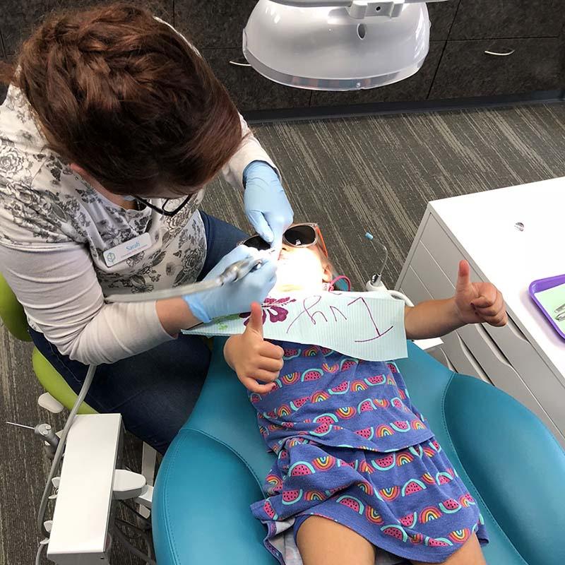 girl getting her teeth clean