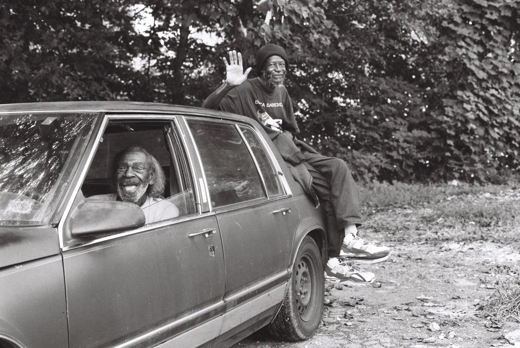 Two black men sitting in Oldsmobile Atlanta GA