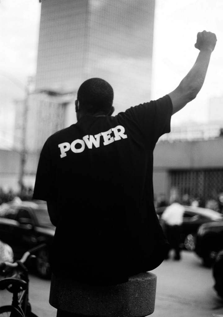 Black power fist during civil rights protest.