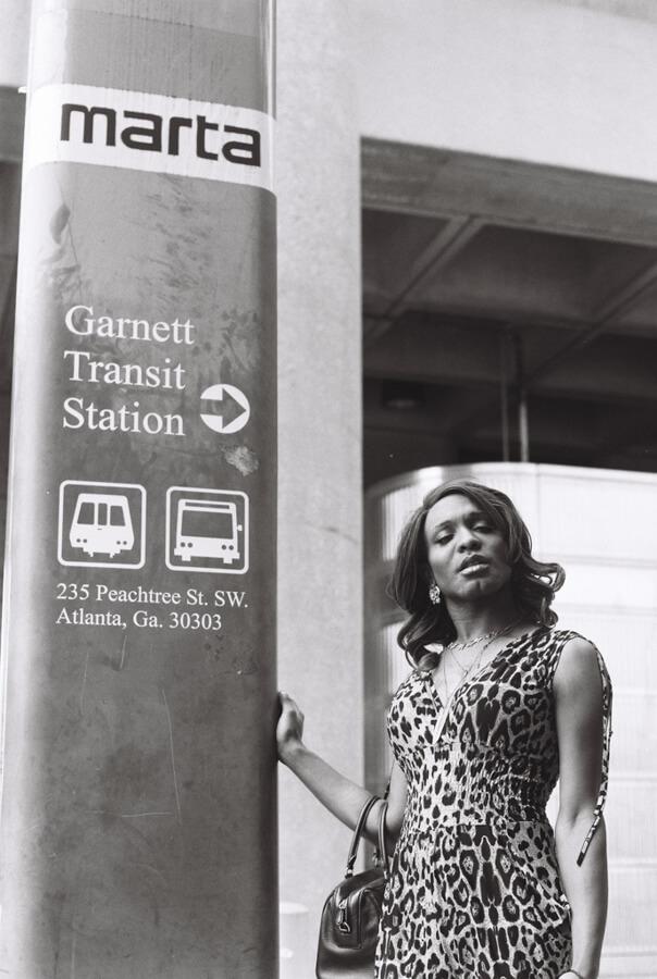 Transgender woman at the Marta station in Atlanta, GA posing with confidence