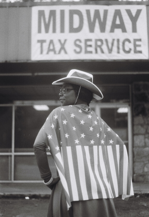 Black women wearing American flag cape