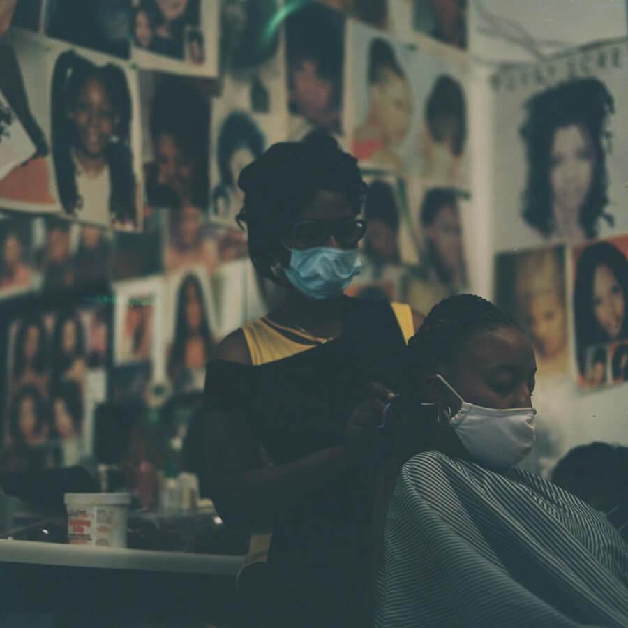 Women braiding in hair salon